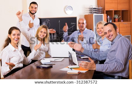 Successful happy young business people during conference call indoors - stock photo