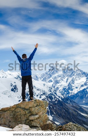 Successful hiking, man and success in the mountains - stock photo