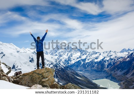 Successful hiking, man and success in the mountains. Fitness and healthy lifestyle outdoors in summer nature - stock photo