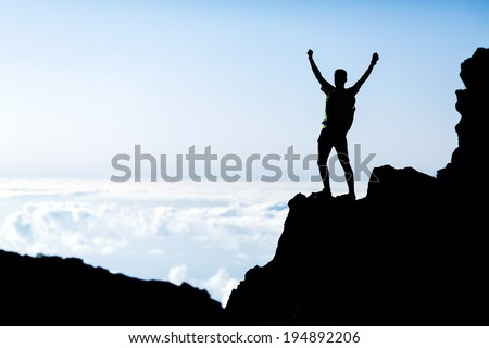 Successful hiking or trail running silhouette, man and success in mountains. Fitness and healthy lifestyle outdoors in summer nature on La Palma, Canary Islands - stock photo