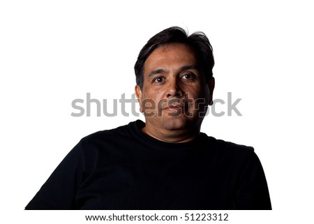 Successful Indian business man confidently looking to camera