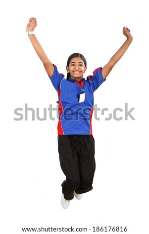 Successful Indian student jumping on white background to celebrate her exam success - stock photo