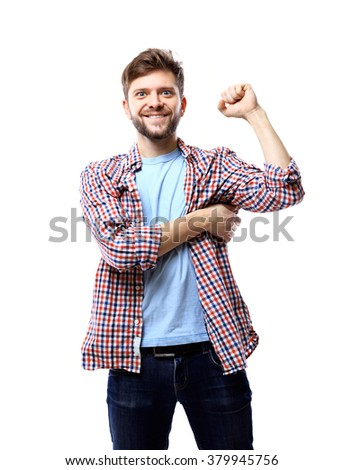 Successful man celebrating with arms up - isolated over white - stock photo