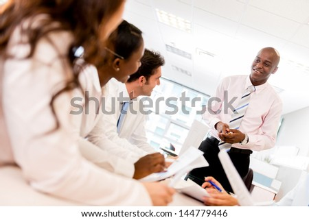 Successful man in a business presentation at the office - stock photo