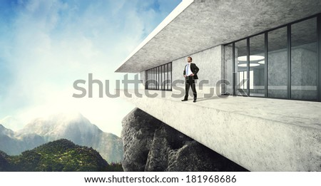 Successful man in his contemporary luxury house in mountains - stock photo
