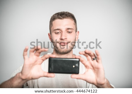 successful man photographs the phone, selfie - stock photo
