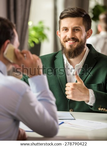 Successful manager sitting at business lunch with colleague. - stock photo