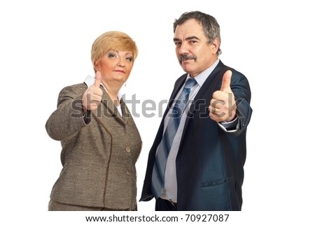 Successful mature business people team giving thumbs up isolated on white background - stock photo