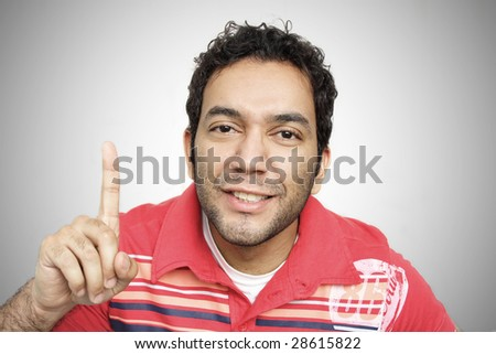 Successful men cheering his victory making number one with finger and looking at camera with angry. - stock photo