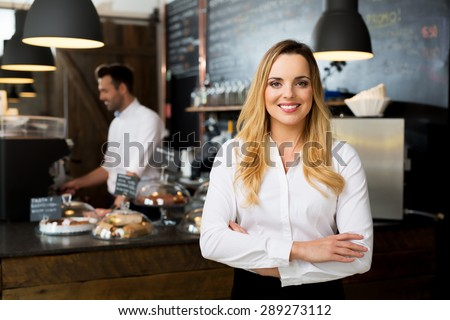 Successful restaurant manager, small business owner at work - stock photo