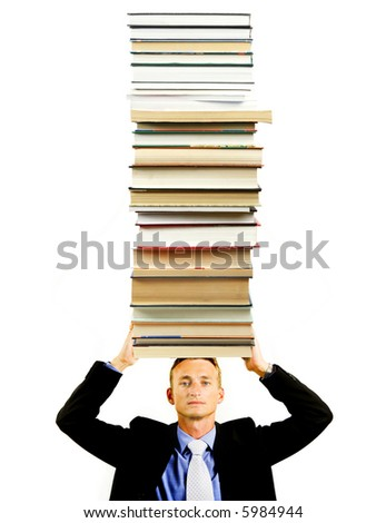 successful student with a tower of books on a head - stock photo