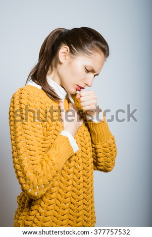 Successful stylish girl coughing isolated in studio