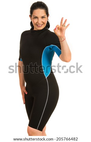 Successful surfer woman showing okay sign hand gesture isolated on white background - stock photo