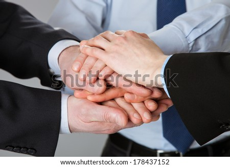 Successful team concept - joined hands of business people - stock photo
