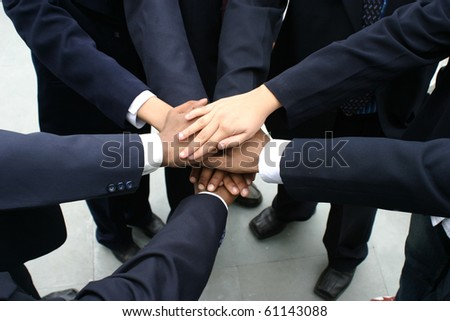 successful team with hands together, close up - stock photo