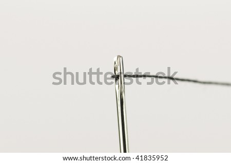Successful thread through needle pin head opening - stock photo
