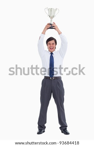 Successful tradesman holding cup against a white background - stock photo