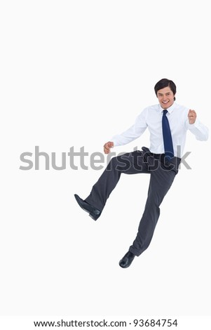 Successful tradesman jumping against a white background - stock photo