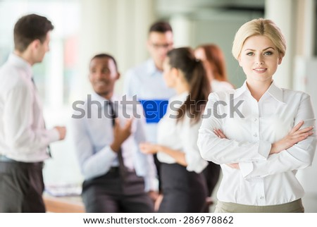 Successful woman at the office leading a business team. - stock photo