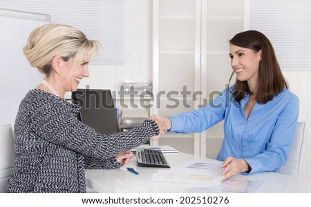 Successful woman business team or handshake in a job interview. - stock photo
