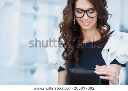 Successful woman holding digital tablet. Businesswoman using internet device and smiling. Professional success concept. - stock photo