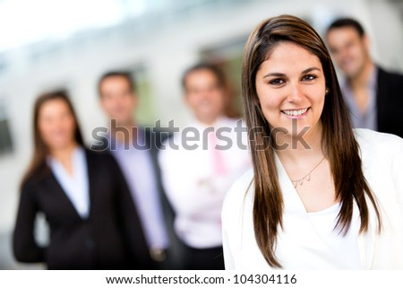 Successful woman leading a business group and smiling