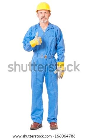 Successful worker shows thumb up gesture isolated on white background - stock photo