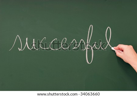 successful written on a blackboard with chalk