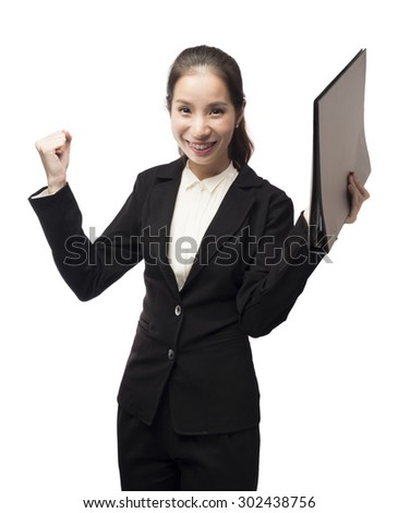 Successful young asian business woman happy for her success. - stock photo