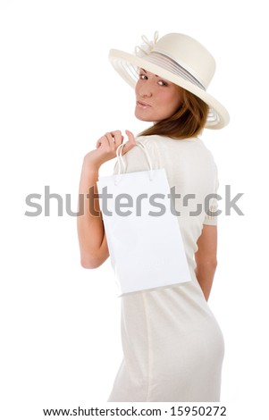 Successful young attractive woman in white dress shopping - stock photo