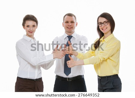 Successful young business people showing thumbs up sign, white background - stock photo