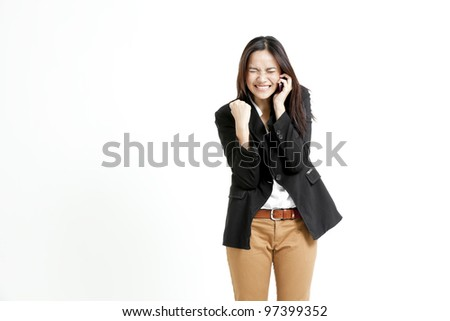 Successful young business woman happy for her success.