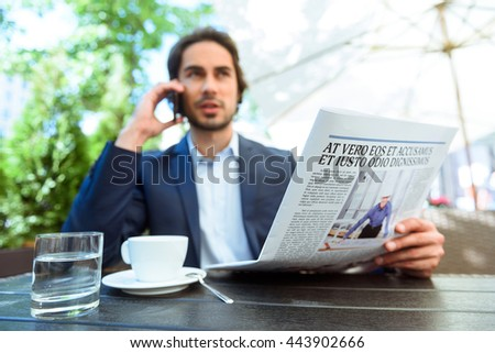 Successful young businessman communicating on telephone