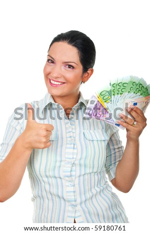 Successful young businessman holding a lot of money and giving thumbs up isolated on white background - stock photo
