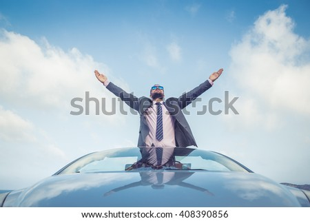 Successful young businessman on a beach. Man standing in the cabriolet classic car. Summer vacations and travel concept - stock photo