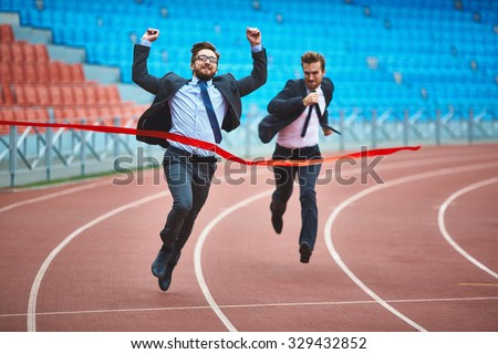 Successful young businessman winning the race