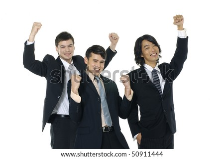 Successful young businesspeople raising hands