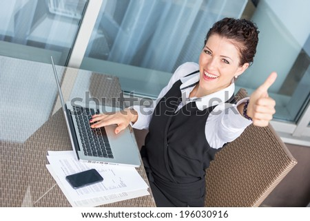Successful Young Businesswoman with Computer - stock photo