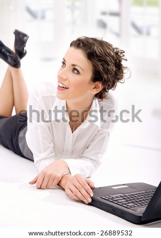 Successful young businesswoman with notebook - stock photo