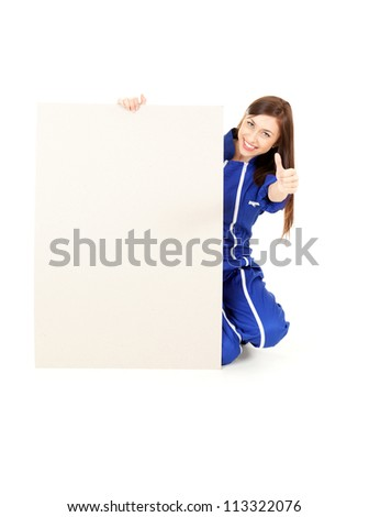 successful young woman in coveralls with empty board and thumb up, white background. - stock photo
