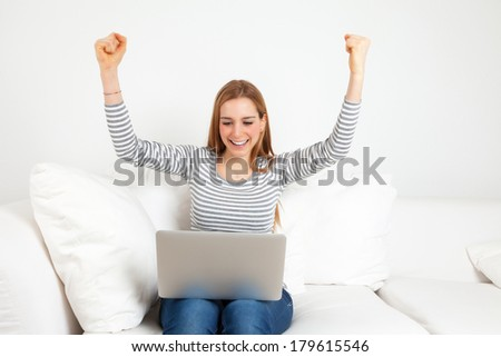 Successful young woman with notebook on a sofa