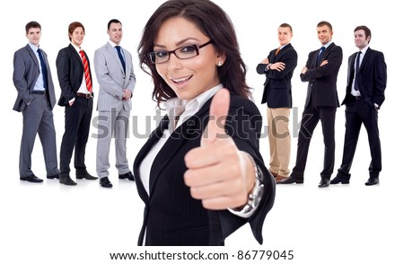 Successfull business woman givinng thumbs up for his team - stock photo
