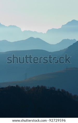 Succession of steamy horizons. Six steamy horizons of hills and mountains at dawn. - stock photo