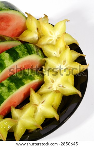Succulent watermelon with tangy star fruit on black plate