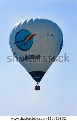 SUCEAVA,ROMANIA - AUGUST 04 :hot air ballon perform at Suceava airshow on August 04, 2012 in Suceava, Romania - stock photo