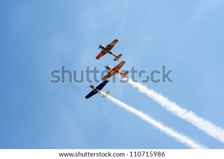 SUCEAVA,ROMANIA - AUGUST 04 :Romanian Aerobatic Team (Iacarii Acrobati) and Jurgis Kairys  perform at Suceava airshow on August 04, 2012 in Suceava, Romania - stock photo