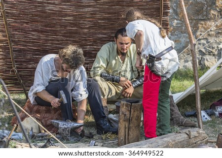 Suceava, Romania - August 15th 2015 - People forging miscellaneous objects at the Medieval Arts Festival held at the Medieval Crown Fortress of Suceava.