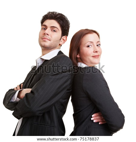 Sucessful business team with arms crossed leaning back to back - stock photo