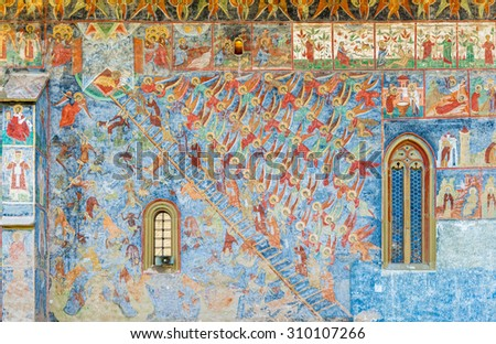 SUCEVITA, ROMANIA - AUGUST 08, 2015 - The Ladder of Divine Ascent, or Ladder of Paradise shows how to raise one's soul and body to God, painted on a wall of Sucevita Monastery in Moldavia, Romania.  - stock photo