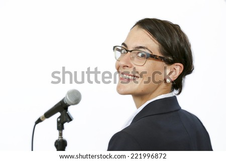 Sucssesful businesswomen keynote speaker in front of microphone before public speaking - stock photo